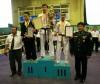 Монгол-Нударга Клубын тамирчин С.Мөнх-Отгон шагналын тавцан дээр, зүүн гар талд багш С.Хаянгарваа, баруун талд нь ХЦДС-ийн захирал хурандаа н.Дашдаваа